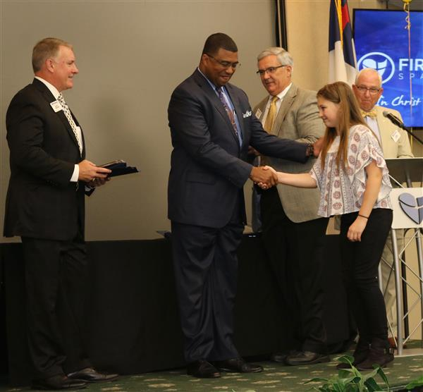 student receiving award from superintendent