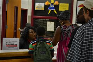 Students and parents get help from the front desk