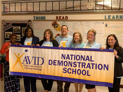 AVID teachers with banner