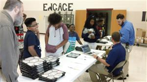 Students receive Macbooks