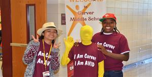 "Two students and ""AVID MAN"" at AVID demonstration"