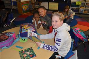 Carver student reading to children