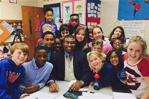 Dr. Booker with students in classroom
