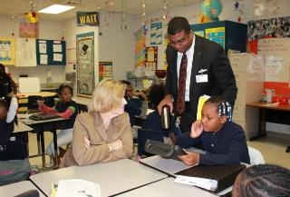 Russell Booker, Molly Spearman, and students in a classroom