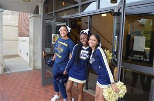 cheerleaders in front of the auditorium