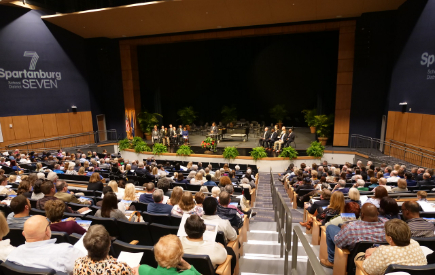 inside the district 7 fine arts theatre during the dedication ceremony