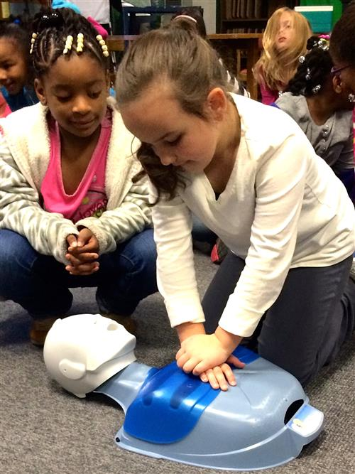 child doing cpr